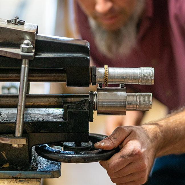 Leather craftsman adjusting equipment